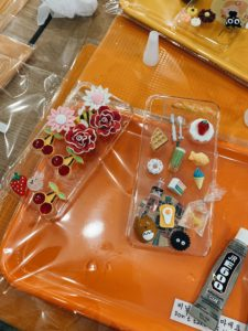 Phone cases with plastic decoration